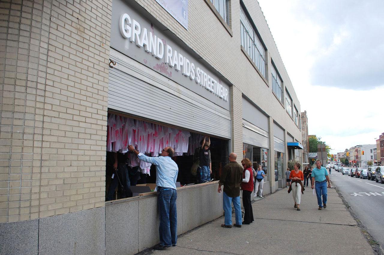 "Pink Prints – Grand Rapids Streetwear. Installation. 2010. Group exhibition ""ArtPrize"". Venue: Site:Lab + U of M School of Art & Design, Fulton / Division, Grand Rapids, MI (USA). Photo: Juliet Hinley."